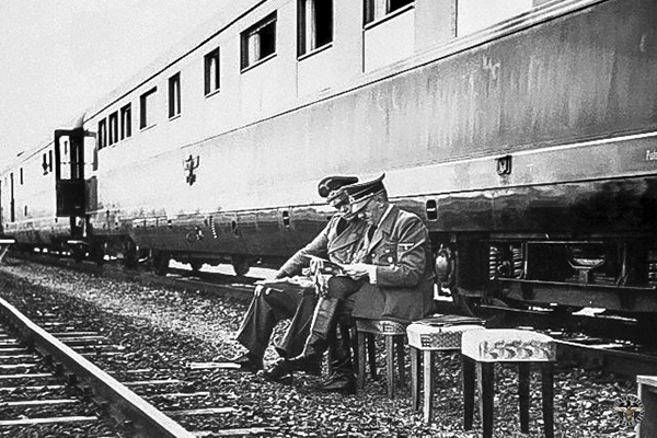 """ca. 1939, Poland --- Adolf Hitler conferring with his Foreign Minister, Joachim van Ribbentrop, beside the """"Fuhrer Train."""" Hit ler is following his armies into Poland. --- Image by © CORBIS"""